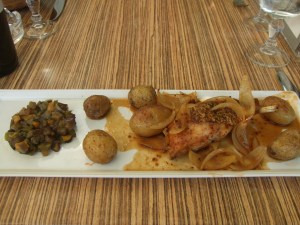 Dish of roast rabbit with potatoes and veg
