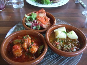 Three dishes of main tapas dishes