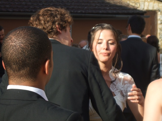 The bride prepares for the kiss