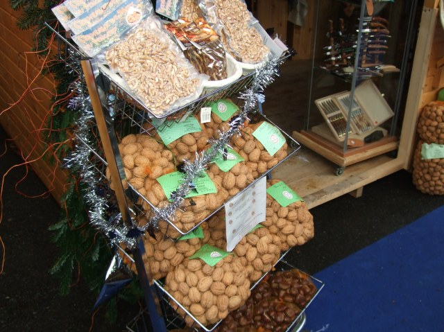 Walnuts and knives for sale.