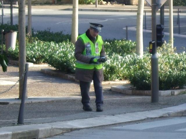 Man in green vest, in Sarlat.