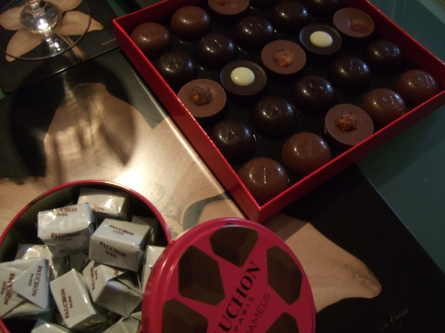A can of caramels, a box of superb chocolates.