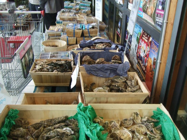 Open boxes of shellfish, ready to be picked out.