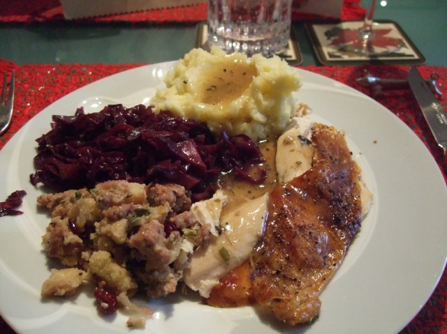 Capon with stuffing, plus red cabbage and mashed potatoes.
