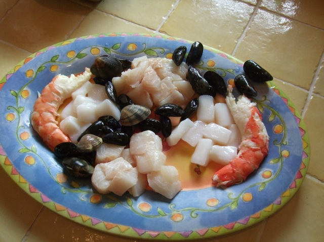 Seafood ready to be immersed in our soupe de poissons.
