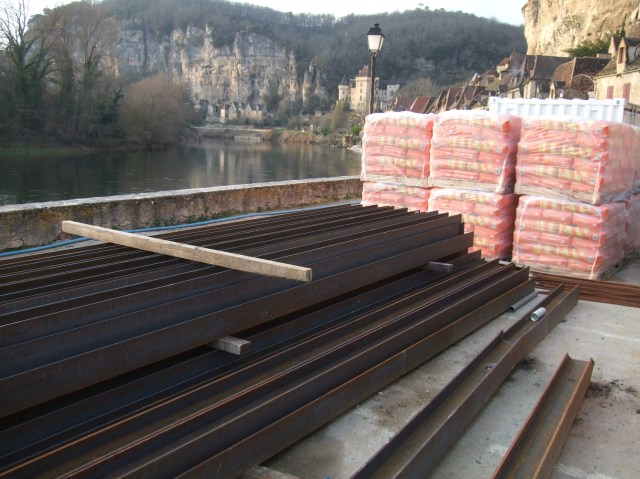 Metal railings stacked up along the Dordogne River.
