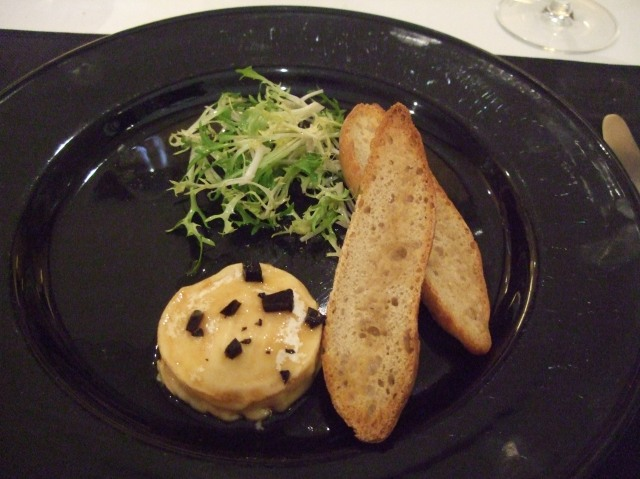 Truffle-studded cheese, with a roll and small salad.