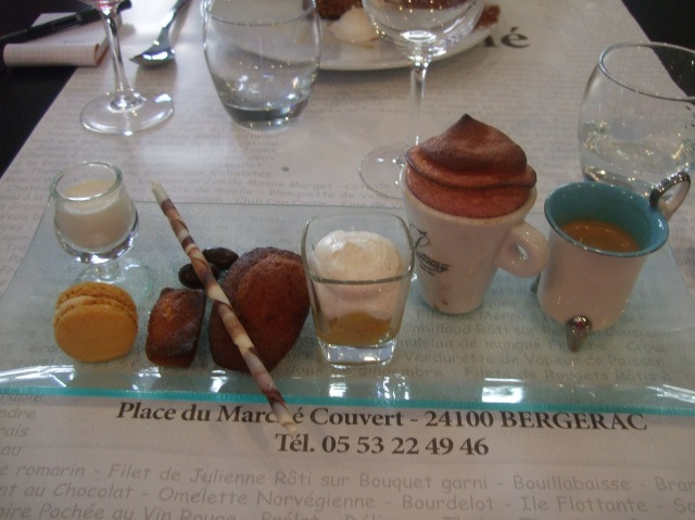 A serving tray of coffee and desserts -- café gourmand.