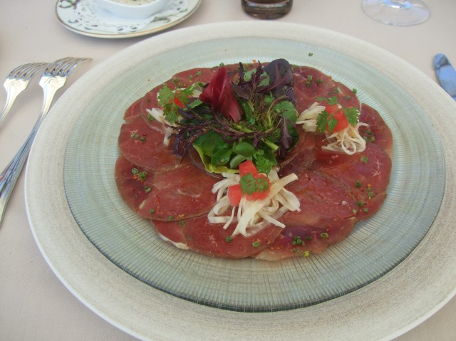 An elegant plate of duck carpaccio.