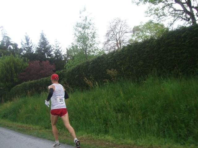 A male runner is striding along well on Saturday morning.