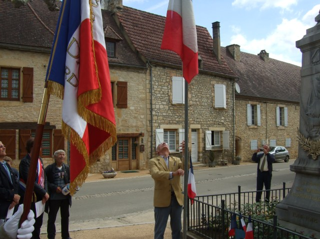 The French flag is rising up the pole.
