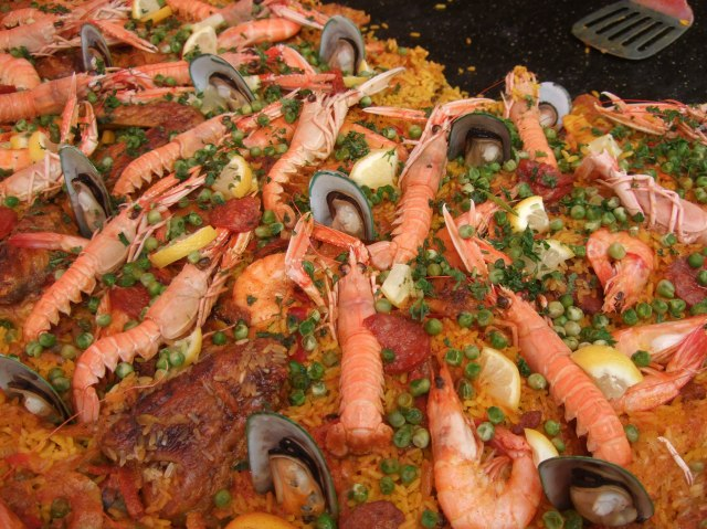 A good number of prawns are decorating this paella.