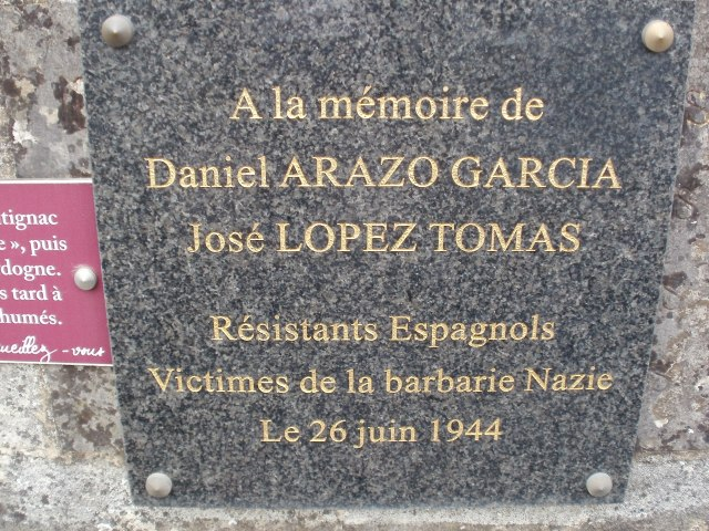 The plaque honouring two Spaniards who were killed here.