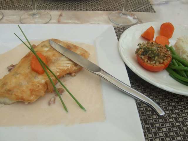 My serving of fish with walnut sauce, and accompanying vegetables.