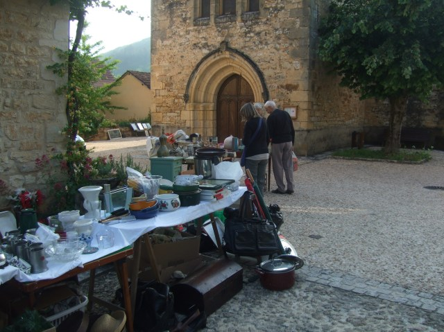 Tables set up in front of Daglan's church.