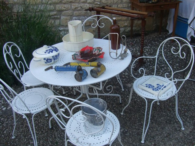 A lovely table -- complete with old insect sprayers.