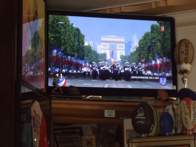 Bastille Day parade on television.