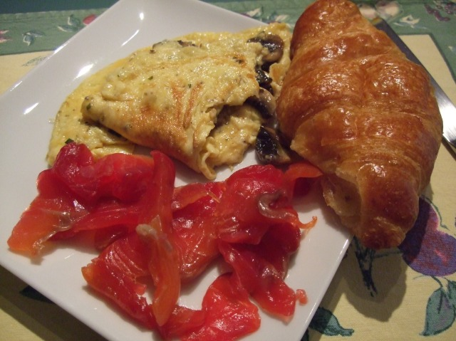 Mushroom omelette, croissant, and salmon. Yummy!
