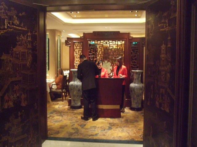 Once you leave the elevator, you reach the Shang Palace's entrance.