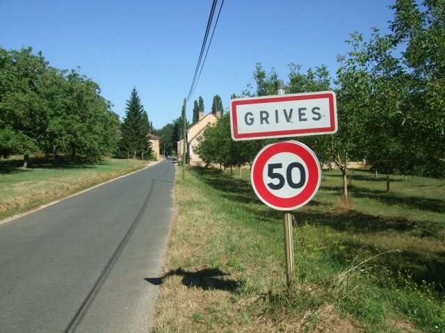 The road flattens out as you coast into the hamlet of Grives.