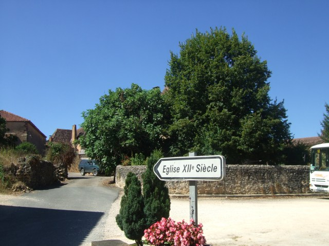 The sign points the way into the hamlet to its 12th Century church.