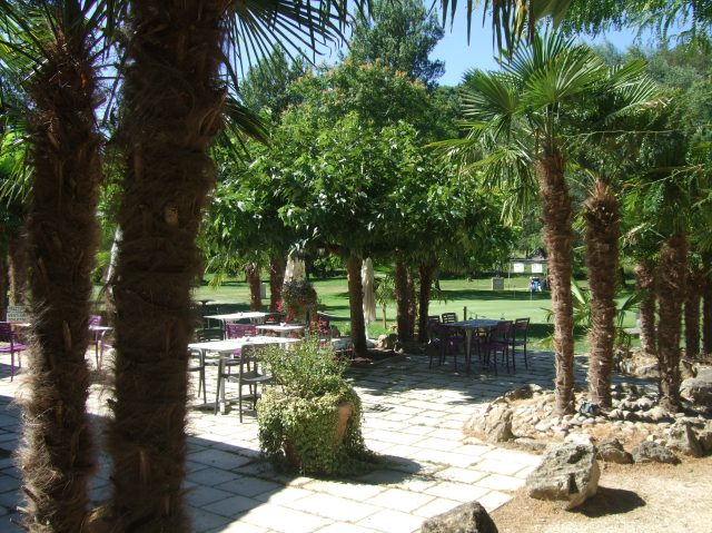 The shaded patio just beside the golf club house.