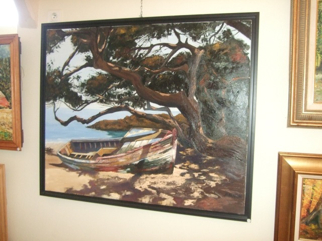 Painting of an old beached boat under a tree.