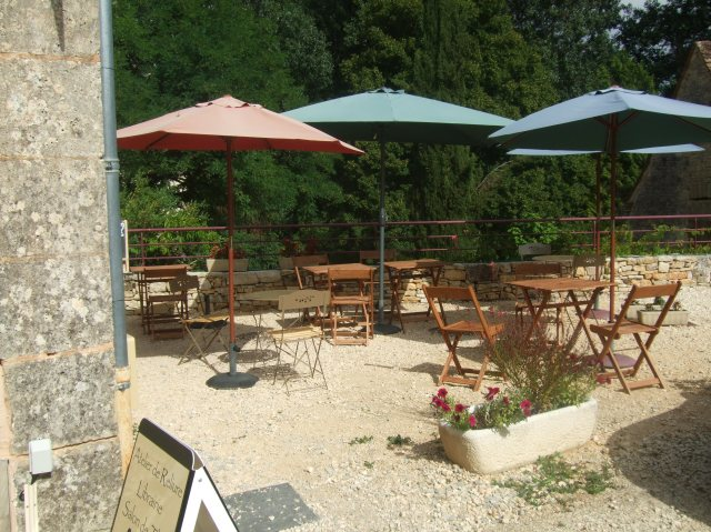 Umbrellas and tables at La Grange aux Livres.