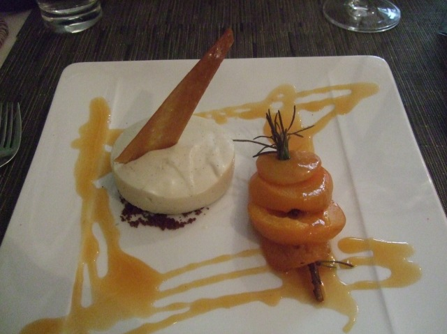 A creamy dessert, accompanied by peaches roasted with rosemary.