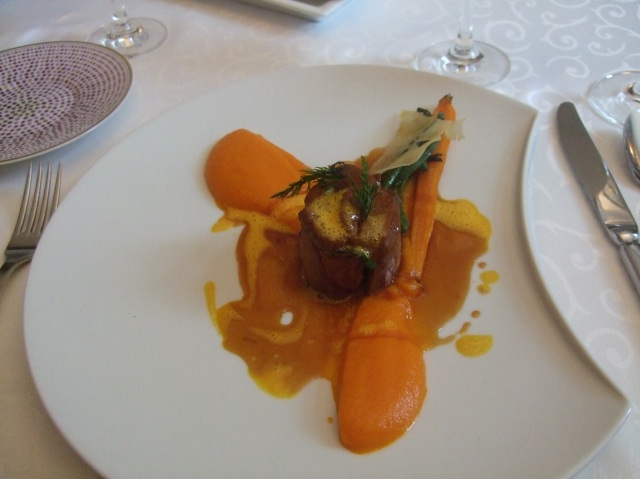 Roast breast of goose with puréed sweet potatoes.