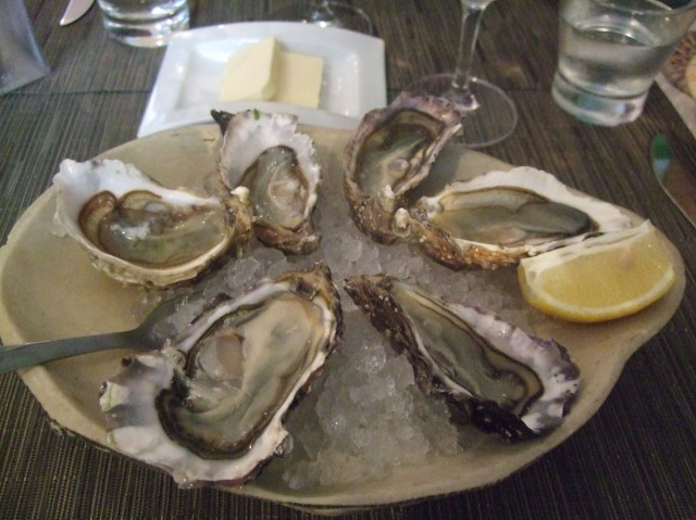 A plate of six oysters, with a simple wedge of lemon. Perfect.