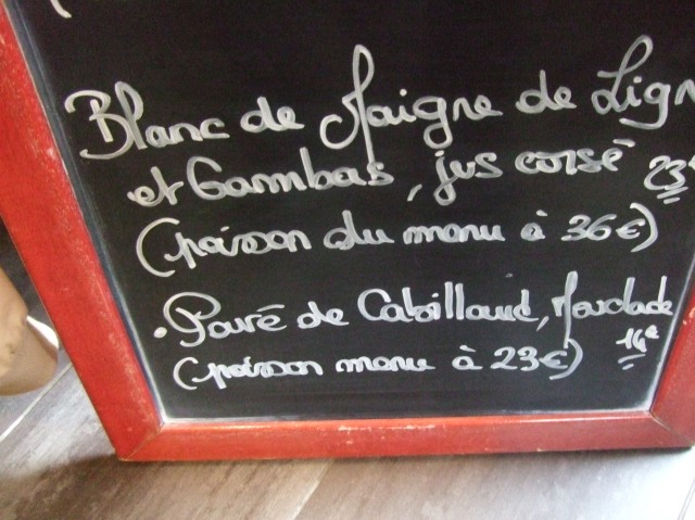 Fish specials at the bottom of the chalkboard, or ardois.
