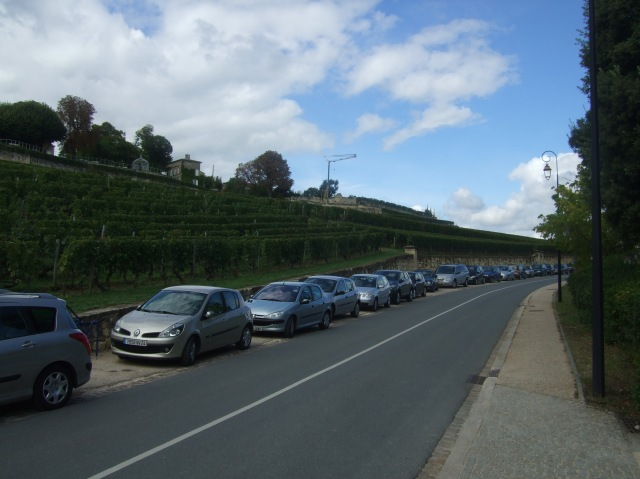 Cars are parked on every bit of the roads leading into town.