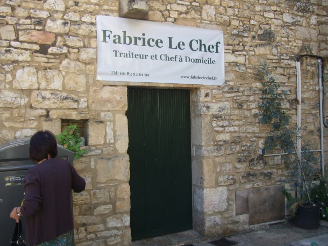 Our Mayor posts some letters in front of the closed Fabrice le Chef shop.