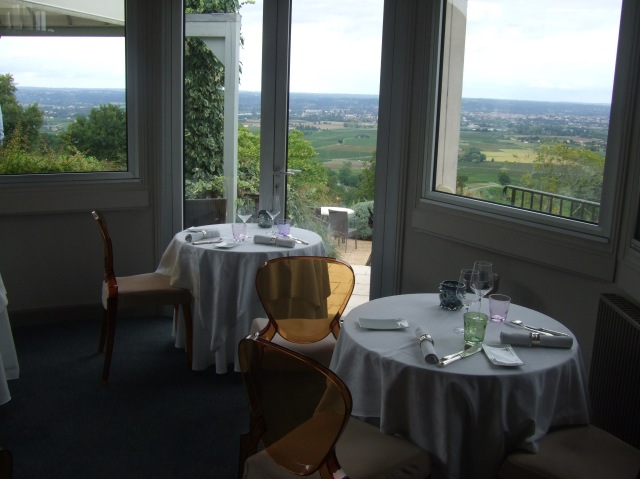 One of the restaurant's rooms, and the countryside beyond.