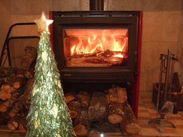 A sparkling artificial tree and a roaring fire.