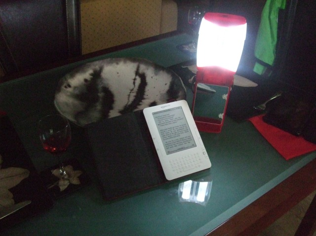 A lantern on the table improves the reading experience.