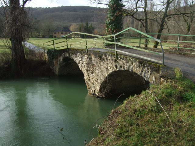The water is running high under the little stone bridge.
