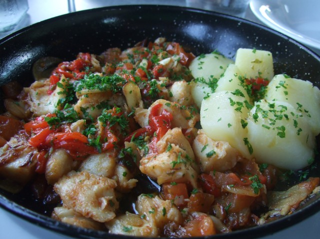 A colourful skillet of food.
