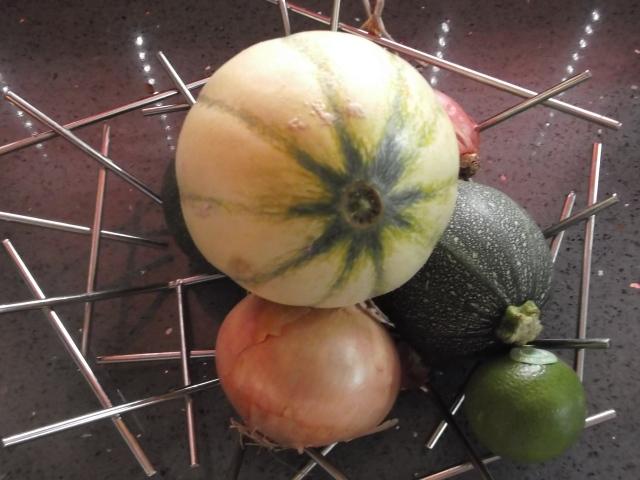 A melon awaits the knife.