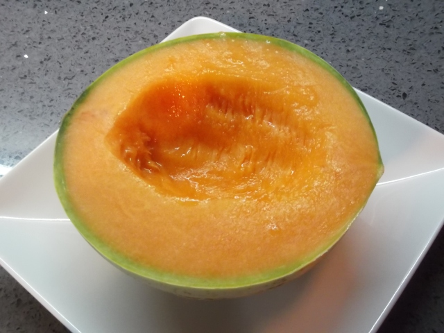 Half a melon, juicy and fragrant.