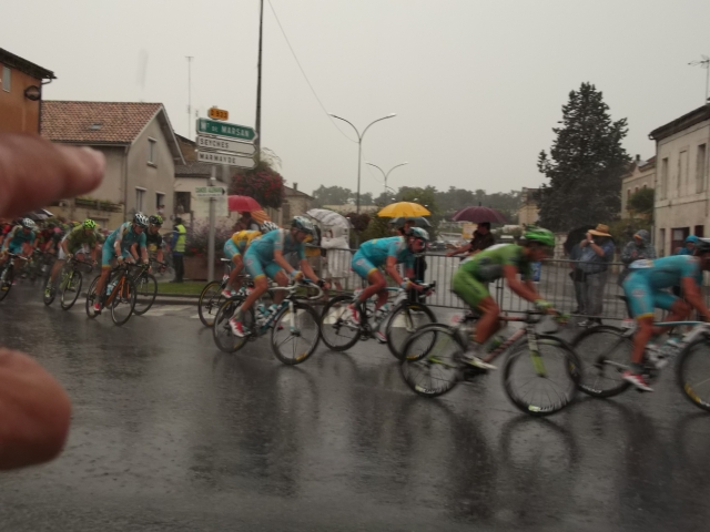 Look for the rider in the yellow jersey.
