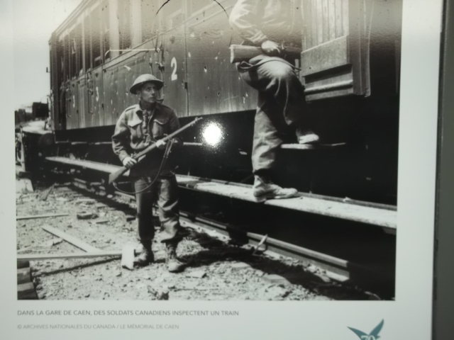One of the photos at the railway station in Caen -- showing Canadian soldiers at Caen.