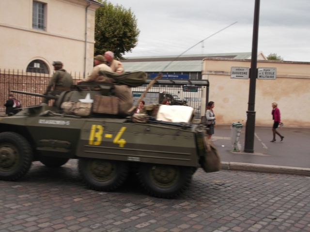 Another army vehicle moves out.