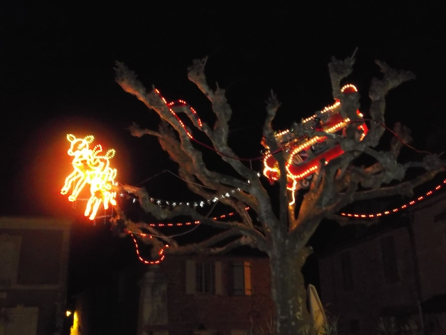 Reindeer made of lights are pulling the sleigh.