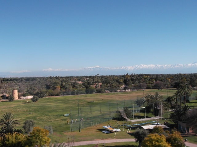 The snow-capped Atlas Mountains are in the distance.