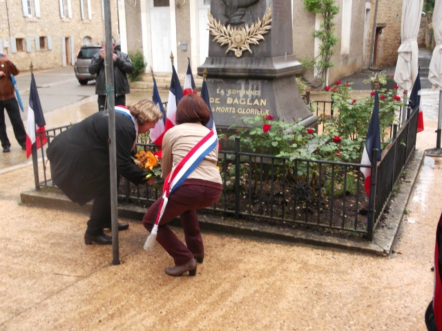 Two of our deputy mayors place an arrangement before the war memorial.
