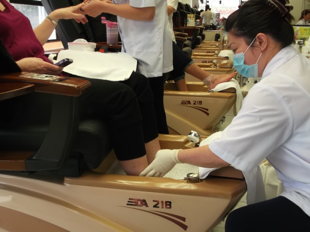 A client gets the full treatment -- manicure and pedicure.