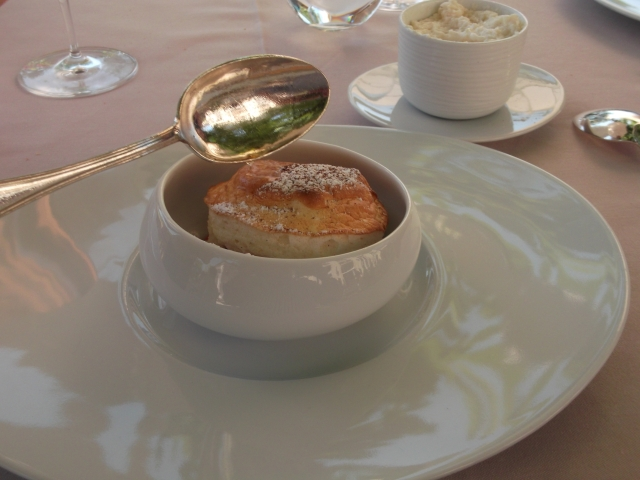 A spoon of flaming eau de vie sets off a delicious dessert soufflé.