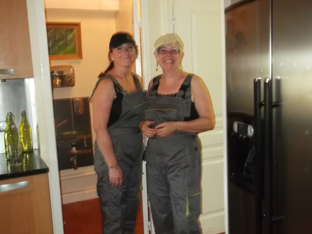 Ready to serve -- in service station coveralls.